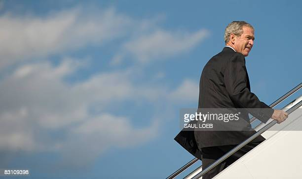 US President George W Bush climbs the stairs of Air Force One prior to departing from Andrews Air Force Base in Maryland on October 3 2008 Bush is...