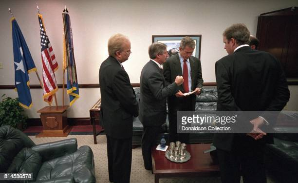 President George W Bush confers with from left Karl Rove Andy Card Dan Bartlett and Ari Fleischer Tuesday Sept 11 prior to delivering remarks on the...