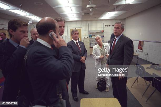 President George W Bush confers with staff members Tuesday Spet 11 at Emma E Booker Elementary School in Sarasota Fla Senior Staff include from left...