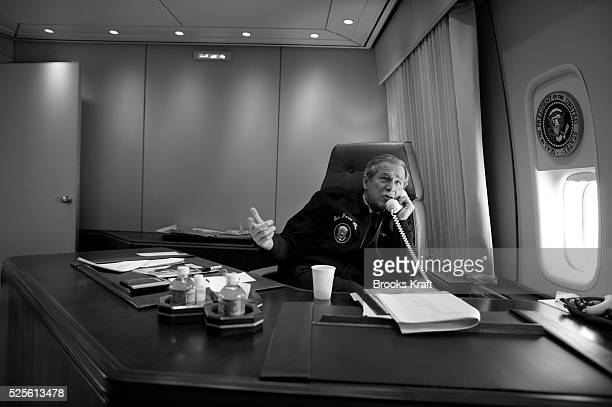President George W Bush congratulates Ariel Sharon on his election victory in his Air Force One office The president was en route to Grand Rapids