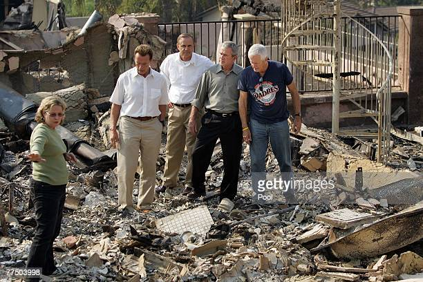 S President George W Bush Congressman Brian Bilbray and Governor Arnold Schwarzenegger meet with Jay and Kendra Jeffcoat who lost their home in the...