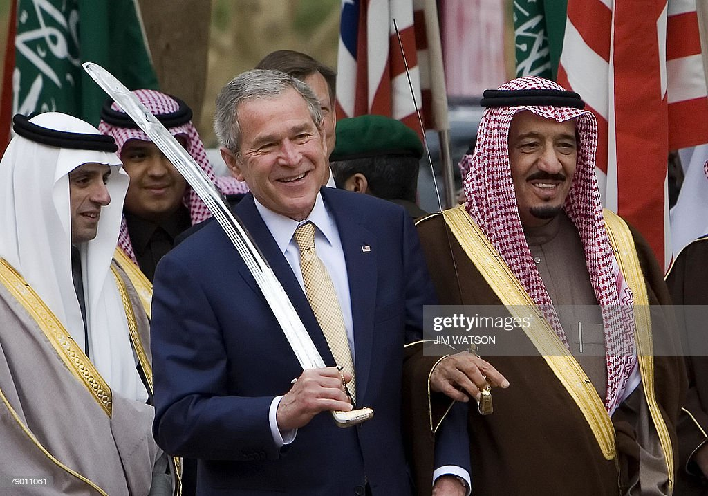 US President George W. Bush dances with a sword with Prince Salman bin Abdul Aziz (R), the brother of the Saudi king and Governor of Riyadh, during their tour of the Murabba Palace and National History History Museum in the Saudi capital, 15 January 2008. Bush holds a second day of talks in Saudi Arabia after his administration announced it was taking the first steps in a multi-billion-dollar arms deal with the kingdom.