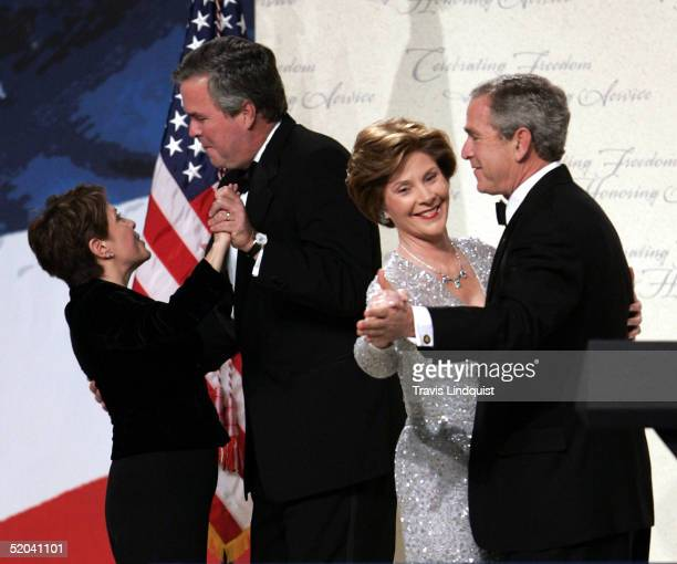 S President George W Bush dances with first lady Laura Bush as his brother Jeb Bush dances with his wife Columba at the Liberty Ball inside the...
