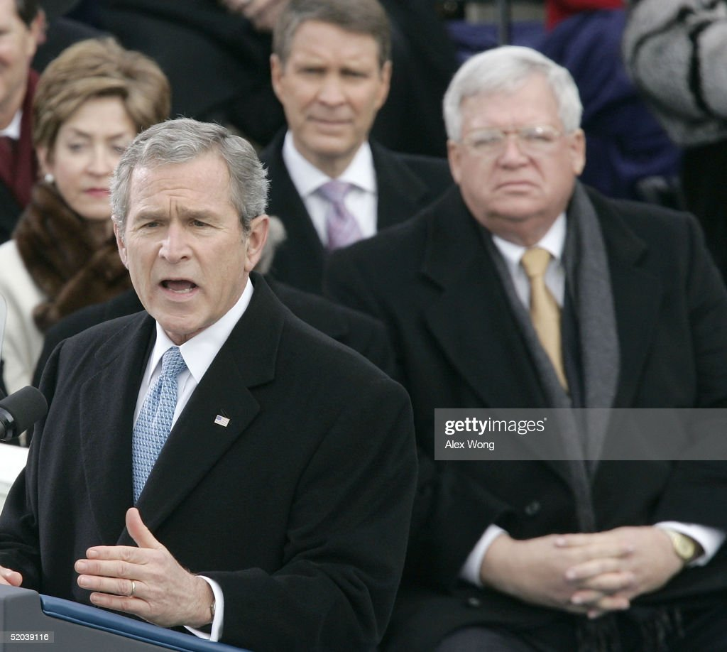 U.S. President George W. Bush (L) delivers his inaugural address after taking the oath of office for his second term during ceremonies on the west front of the U.S. Capitol U.S. Senator Trent Lott (R-MS) (Rear-C) and U.S. Rep. Dennis Hastert (R-IL) (R) listen January 20, 2005 in Washington, DC. In his address, President Bush outlined his plans to pursue freedom around the world as well as push a legacy-setting agenda at home championing 'freedom in all the world' as the surest path to peace.
