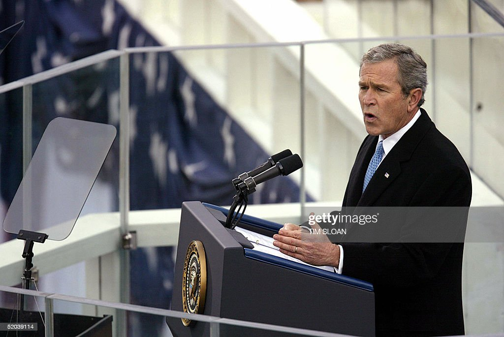 US President <a gi-track='captionPersonalityLinkClicked' href=/galleries/search?phrase=George+W.+Bush&family=editorial&specificpeople=122011 ng-click='$event.stopPropagation()'>George W. Bush</a> delvers his inauguration speech 20 January, 2005, on the west side of the US Capitol in Washington, DC. Bush launched his second term Thursday with an urgent pledge to spread freedom to 'the darkest corners of our world' and vowed to heal divisions like those over the war in Iraq.