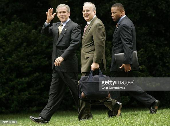 US President George W Bush Deputy Chief of Staff Karl Rove and Assistant to the President for Domestic Policy Claude Allen walk from the Oval Office...