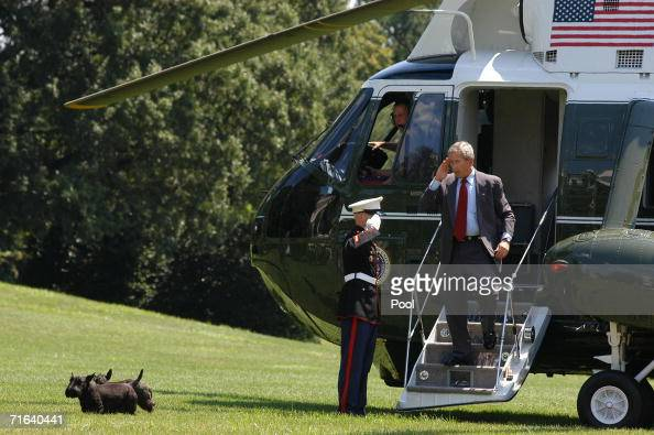 S President George W Bush disembarks Marine One as he arrives on the South Lawn of the White House with his dogs Barney and Miss Beazley August 13...