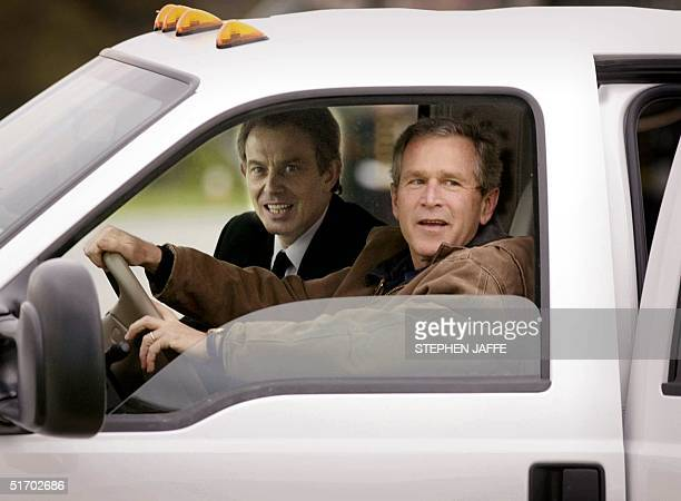 President George W Bush drives with British Prime Minister Tony Blair in his truck after Blair arrived at the Bush's Prairie Chapel Ranch 05 April...