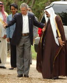 S President George W Bush escorts Saudi Crown Prince Abdullah to his private office as US Secretary of State Condoleezza Rice looks on April 25 2005...