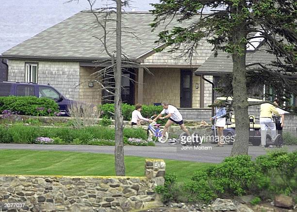 S President George W Bush falls off a Segway Scooter at his parent's home with first lady Laura Bush daughter Jenna Bush and Father George H Bush...
