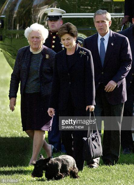 President George W Bush First Lady Laura Bush and his mother Barbara Bush arrive 04 November 2001 via Marine One on the South Lawn of the White House...