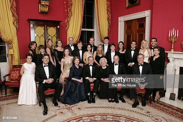 President George W Bush first lady Laura Bush former first lady Barbara Bush and former President George HW Bush sit surrounded by family in the Red...