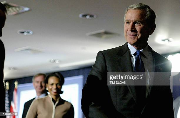 President George W Bush followed by National Security Advisor Condoleezza Rice walks from a press conference given by him and British Prime Minister...
