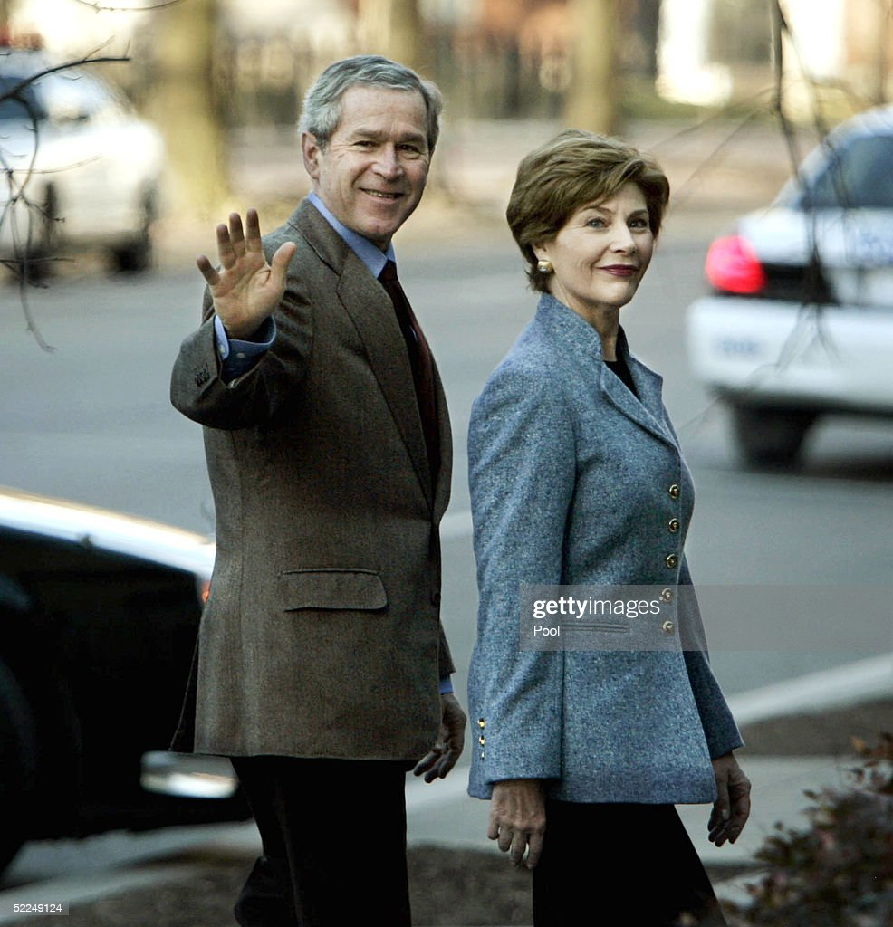 U.S. President George W. Bush gestures as he and his wife, first lady Laura Bush, attend St. John's church February 27, 2005 in Washington, DC.