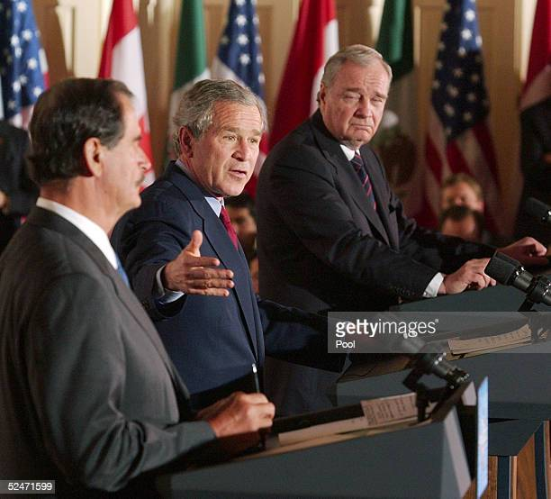S President George W Bush gestures during a press conference with Mexican President Vicente Fox March 23 2005 along with Canadian Prime Minister Paul...