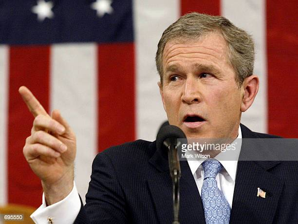 S President George W Bush gestures while delivering his State Of the Union address before a joint session of Congress January 29 2002 at the US...