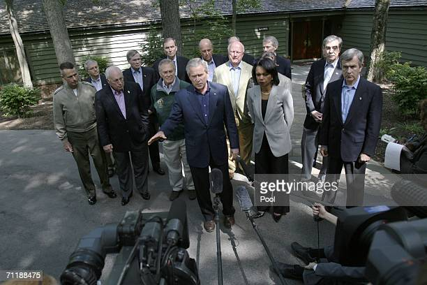 US President George W Bush gestures while speaking to the media as members of his staff Chairman of the Joint Chiefs of Staff General Peter Pace...