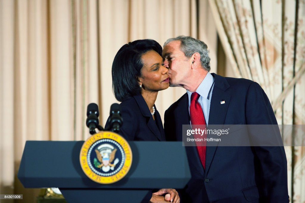 U.S. President George W. Bush gives a kiss on the cheek to Secretary of State Condoleezza Rice at an event to celebrate his administration's foreign policy achievements on January 15, 2009 in Washington, DC. At the event, President Bush awarded Ambassador Ryan Crocker the Presidential Medal of Freedom.
