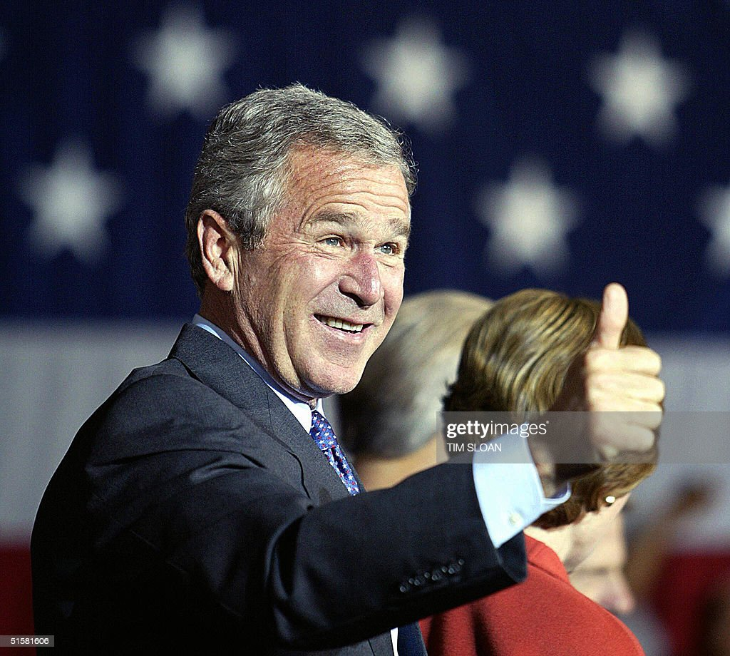 US President George W. Bush gives a 'thumbs up' during a campaign rally stop 27 October, 2004, in Vienna, Ohio. Breaking his silence on missing Iraqi explosives, Bush on Wednesday called Democratic rival John Kerry's attacks on the subject 'wild charges' levelled in desperation.