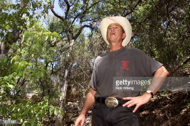President George W Bush gives the press a tour in a canyon he calls 'The Cathedral' on his ranch August 25 2001 in Crawford Texas
