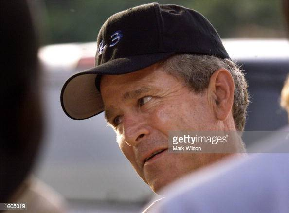 President George W Bush greets a crowd of supporters after a round of golf at Andrews Air Force Base July 27 2001 in Camp Springs MD