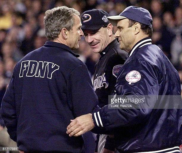 President George W Bush greets Arizona Diamondback manager Bob Brenley and New York Yankee manager Joe Torre after throwing out the ceremonial 'first...