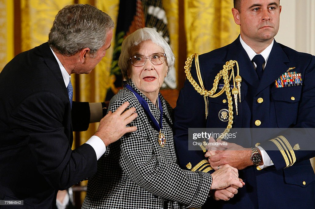 U.S. President George W. Bush (L) greets Harper Lee (C), Pulitzer Prize winner and the author of 'To Kill A Mockingbird,' after he presented her with a Presidential Medal of Freedom during a ceremony for the 2007 recipients in the East Room of the White House November 5, 2007 in Washington, DC. The Medal of Freedom is given to those who have made remarkable contributions to the security or national interests of the United States, world peace, culture, or other private or public endeavors.