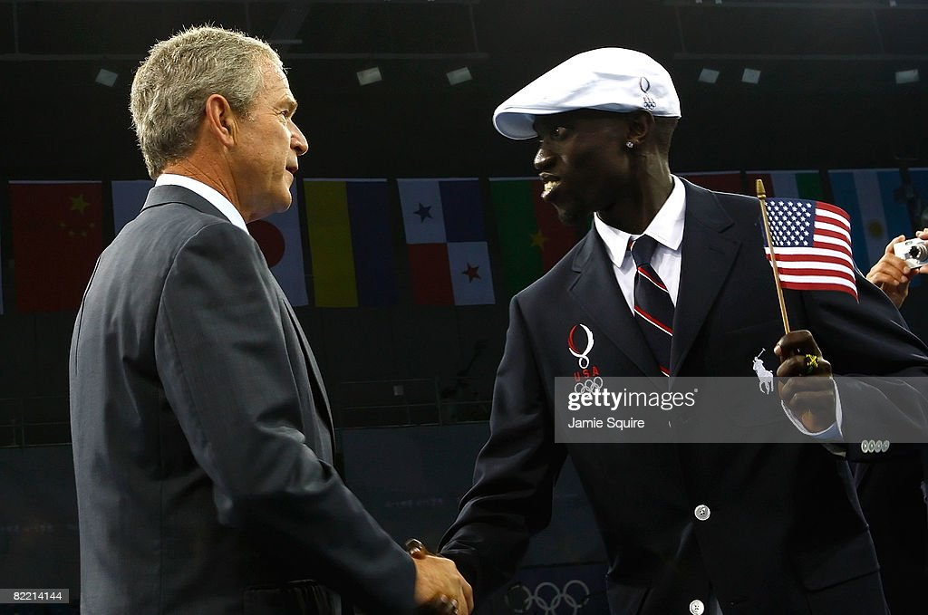 US President George W. Bush greets Lopez Lomong, runner and flagbearer for the United States of America Olympic team, on the opening day of the Beijing 2008 Olympic Games on August 8, 2008 in Beijing, China.