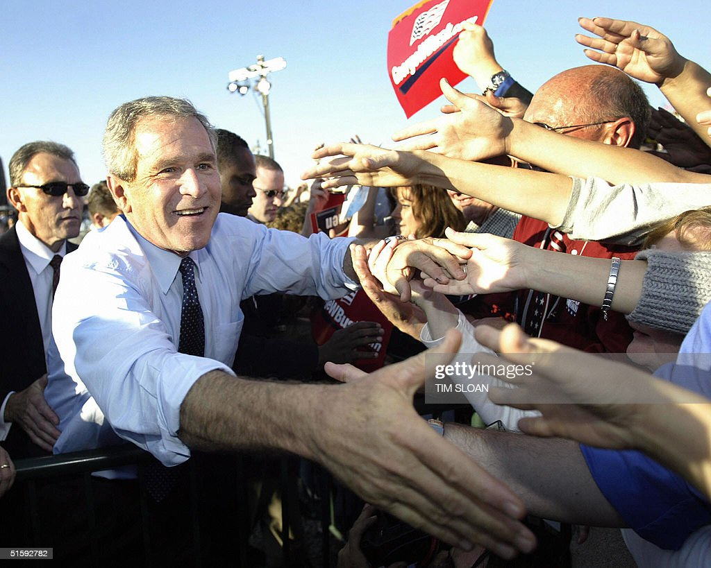 US President George W. Bush greets supporters at a campaign rally at the county fair grounds 27 October, 2004, in Findlay, Ohio. Bush's reelection campaign said Wednesday it had cut its website off from access from certain foreign countries 'for security reasons,' but declined to elaborate.