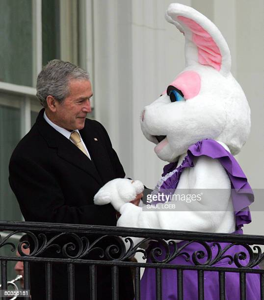 US President George W Bush greets the Easter Bunny during the annual Easter Egg Roll on the South Lawn of the White House in Washington DC on March...