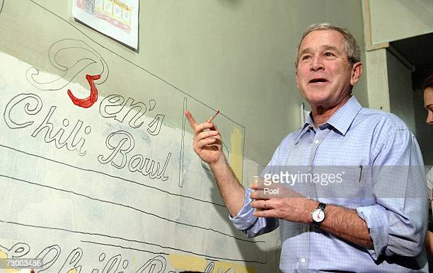 US President George W Bush helps paint a mural along side City Year volunteers as part of a community service activity in honor of Martin Luther King...