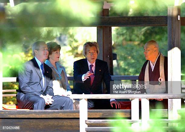 US President George W Bush his wife Laura Bush Japanese Prime Minister Junichiro Koizumi and chief monk Raitei Arima are seen at the Kinkakuji Temple...