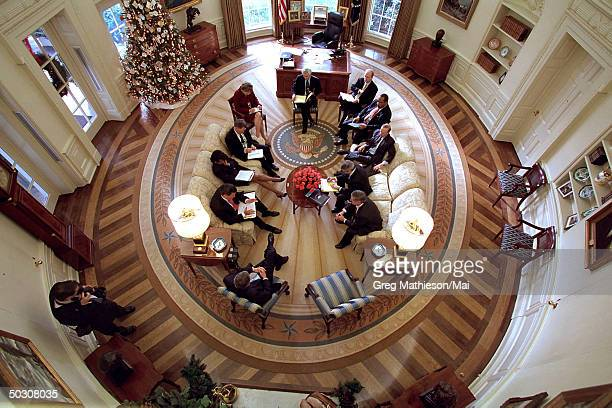 President George W Bush hosting meeting in Oval Office of White House decorated w new presidential rug The rug which is unique to the Bush...