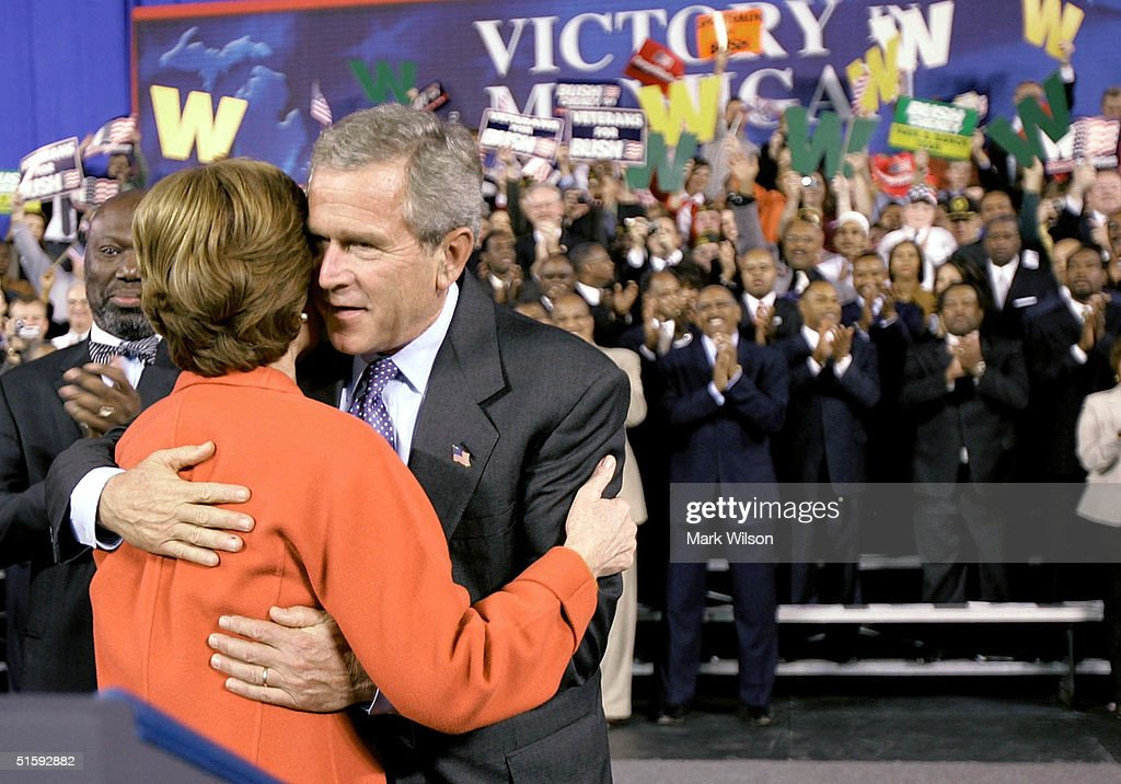 U.S. President George W. Bush hugs his wife first lady Laura Bush before speaking during a campaign rally at the Silverdome, October 27, 2004 in Pontiac, Michigan. Recent polls show that the president is in a neck and neck race his challenger, Democratic presidentail candidate John Kerry (D-MA).