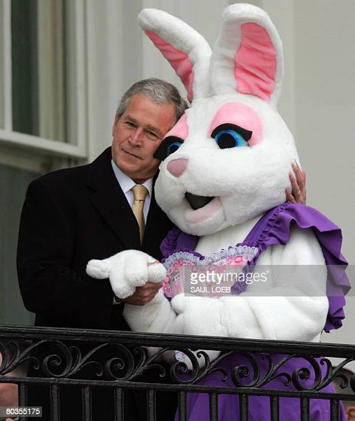 US President George W Bush hugs the Easter Bunny during the annual Easter Egg Roll on the South Lawn of the White House in Washington DC on March 24...