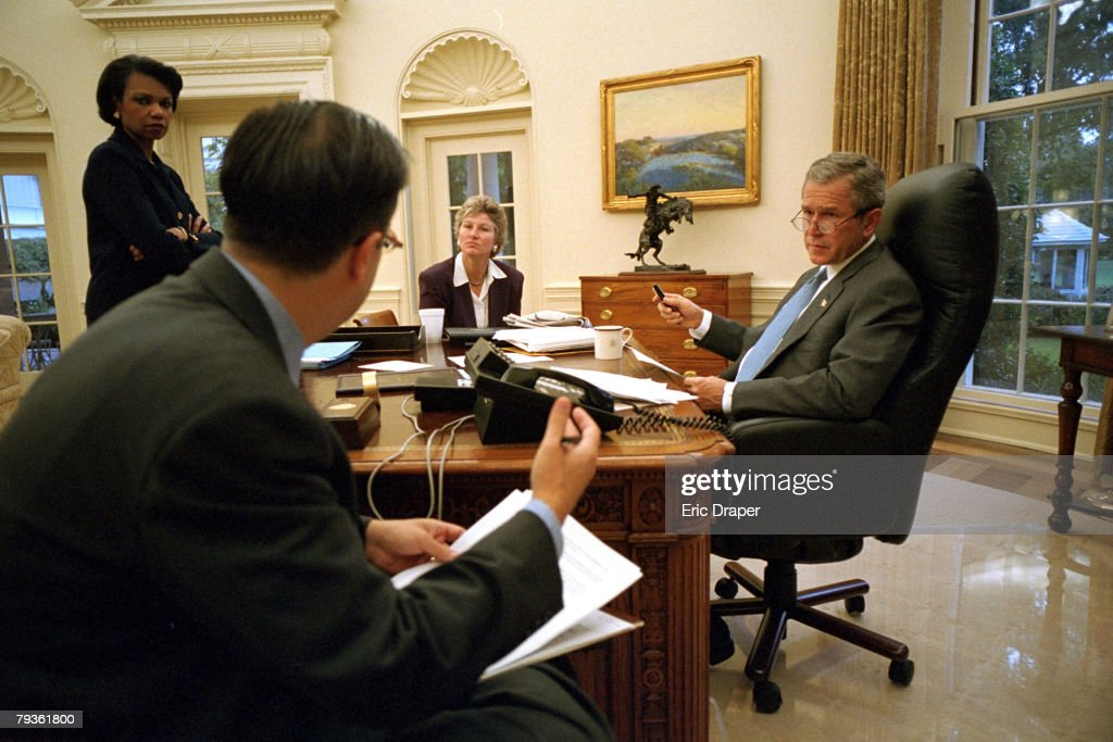 President George W Bush in the Oval Office Thursday morning prepares for his evening address to Congress and the nation with Mike Gerson Director of...
