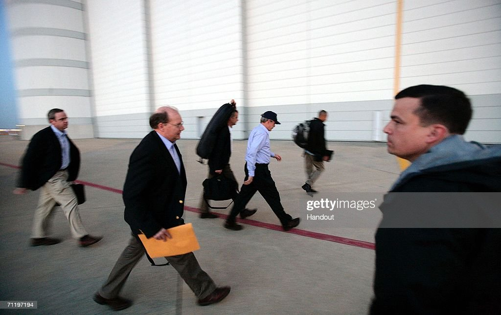President George W Bush is accompanied by Deputy Chief of Staff Joe Hagin and Dan Bartlett counselor to the president June 12 2006 at Andrews Air...