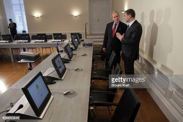 US President George W Bush is given a tour of the cabinet room by Estonian Prime Minister Andrus Ansip at Stenbock House in Talinn Estonia November...
