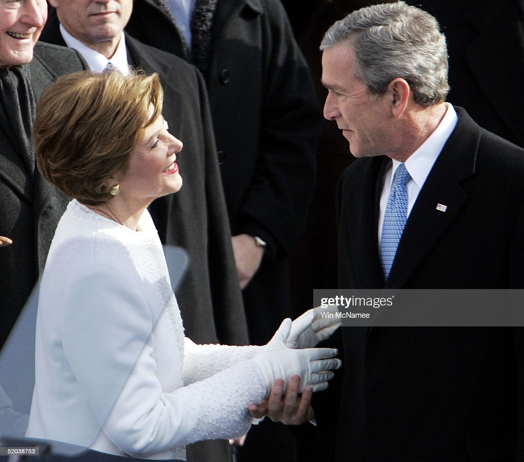 U.S. President George W. Bush is greeted by his wife Laura Bush as he enters the inaugural stage January 20, 2005 in Washington, D.C. U.S. President George W. Bush will be sworn in for a second term during the inaugural ceremony.