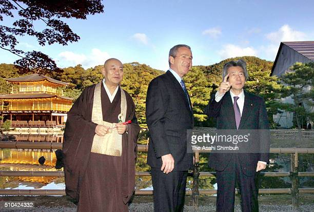 US President George W Bush is seen at the Kinkakuji Temple with Japanese Prime Minister Junichiro Koizumi and chief monk Raitei Arima on November 16...
