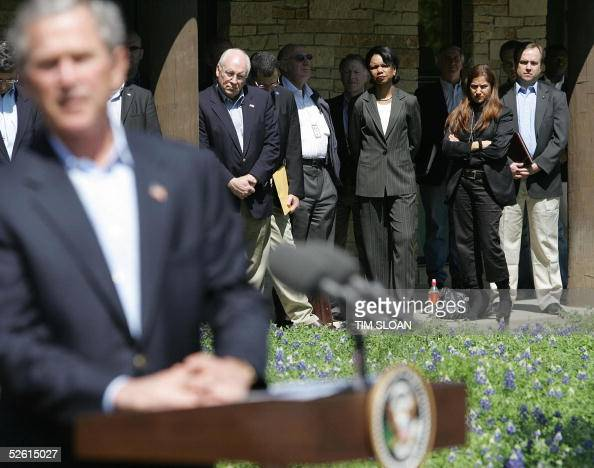 President George W Bush is watched by his staff during his joint press meeting with Israel's Prime Minister Ariel Sharon including Vice President...