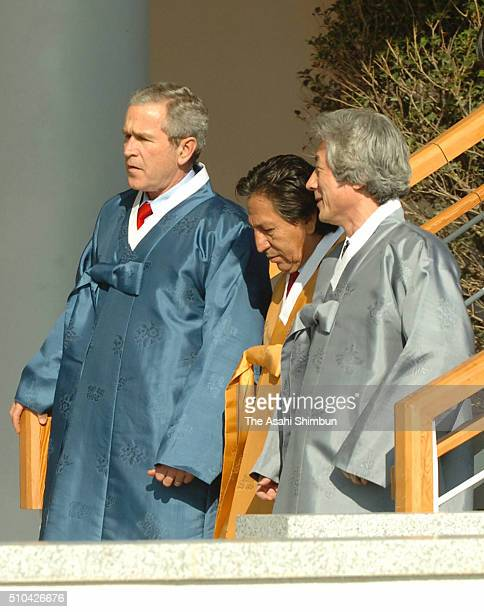 US President George W Bush Japanese Prime Minister Junichiro Koizumi and Peruvian President Alejandro Toledo talk while walking to attend the family...