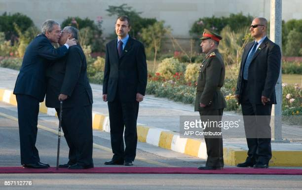 US President George W Bush kisses Iraq's President Jalal Talabani during an arrival ceremony at Salam Palace during an unannounced visit to Baghdad...