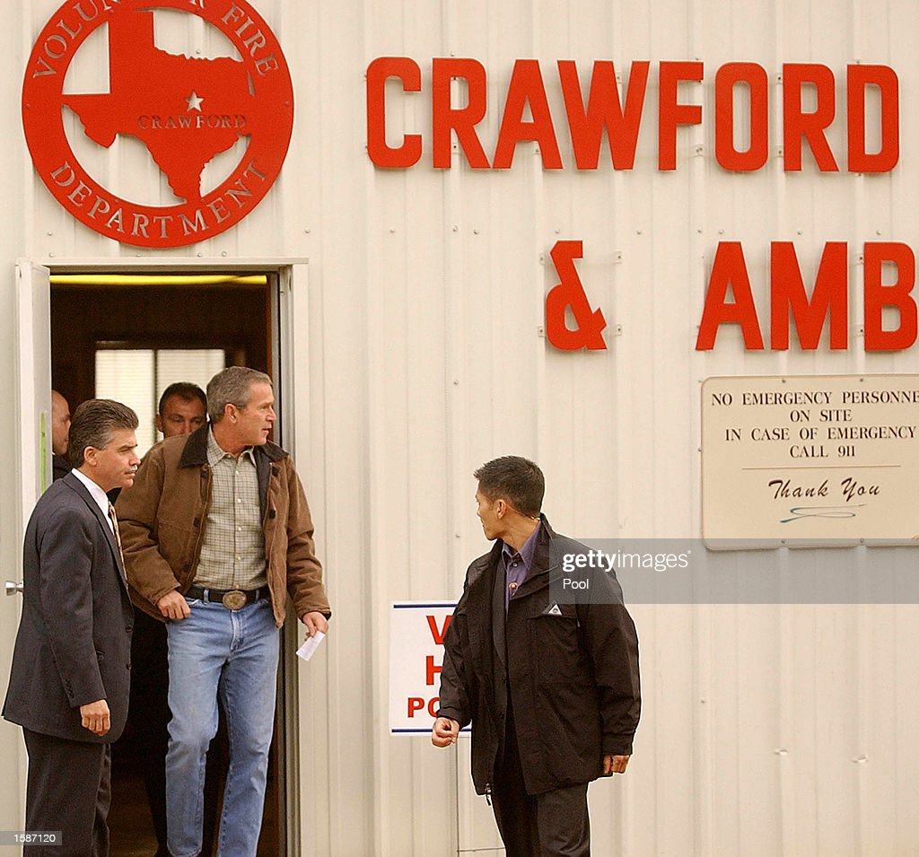 S President George W Bush leaves a polling station at the Crawford Fire Department after casting his ballot before heading back to Washington DC...