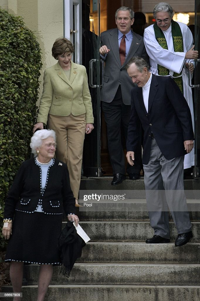 US President George W Bush leaves St John's Church with first lady Laura Bush and his parents former US President George HW Bush and mother Barbara...