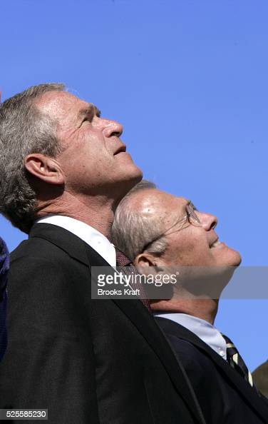 US President George W Bush left and Secretary of Defense Donald Rumsfeld watch US Air Force jets fly over Summerall Field during an Armed Forces...