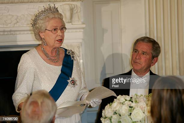 President George W Bush listens as Queen Elizabeth II gives a speech during a State Dinner at the White House on the fifth day of her USA tour on May...