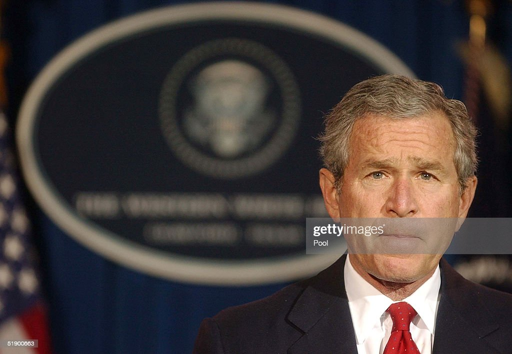 U.S. President <a gi-track='captionPersonalityLinkClicked' href=/galleries/search?phrase=George+W.+Bush&family=editorial&specificpeople=122011 ng-click='$event.stopPropagation()'>George W. Bush</a> listens to a question during a news conference at his ranch December 29, 2004 near Crawford, Texas. President Bush spoke on a large number of issues including the aid for the Tsunami victims, Iraq elections as well as flooding on the West Coast.