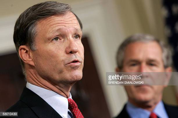 President George W Bush listens to California Republican Representative Christopher Cox speak after Bush nominated him for chairman of the Securities...