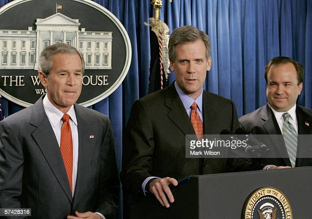 US President George W Bush listens to Tony Snow speak at the podium after Bush announced that Snow will replace Scott McClellan as the new White...